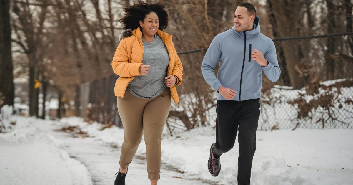 Running smiling illustrating exercise makes you happy mentally.